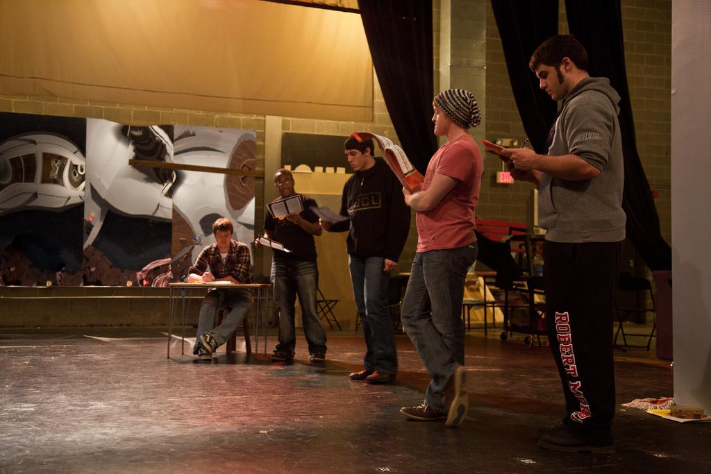 Students practice their lines during rehearsal for