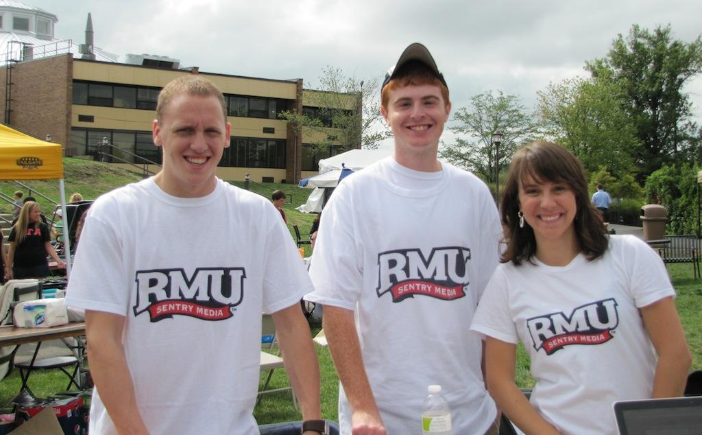 RMU Sentry Media staff members model the T-shirts raffled off at the Activities Fair Wednesday.