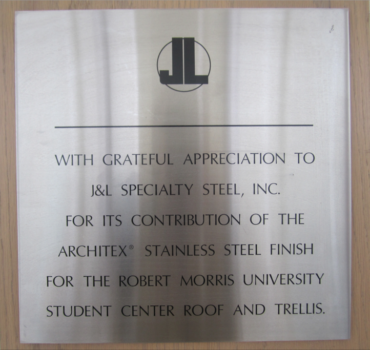 The roofs on certain buildings on campus showcase J&L Steel.  This plaque is located in the Nicholson Center near Romo's Cafe.