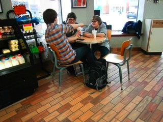 Even in these cold winter months the shop has its regulars. These Quaker Valley students are attracted here for the 25-cent soft drinks. The place is a quiet hangout for the students, and a nice place to wind down after a day of classes.