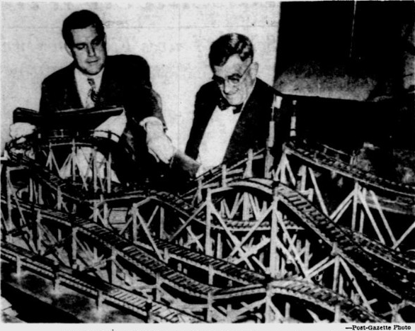 Ed Vettel Sr. (Right) & Ed Vettel Jr. (Left) discuss a roller coaster model & design.  Both Father & Son worked at Pittsburgh's West View Park.