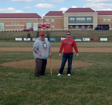 Joe Marek stands on the pitcher's mound and prepare to throw his inaugural first pitches on the new field to catcher Austin Hoffman. Hoffman threw the first pitch to open McCormick Baseball field when he was in fifth grade