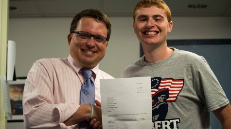 Dr. Anthony Moretti congratulates Nick Buzzelli for winning SCJ Student Journalist of the Year.