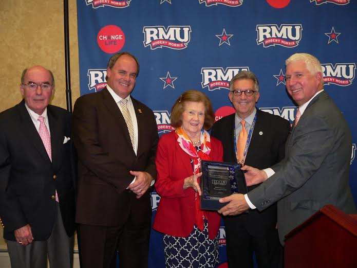 David Synowka inducts the Rooney family into the RMU Sport Management Hall of Fame on October 17.