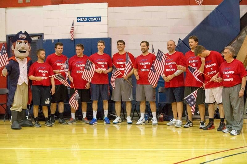 Members+of+the+RMU+faculty+team+await+to+be+introduced+prior+to+the+Troops+%27N+Hoops+charity+basketball+game+Tuesday+night.