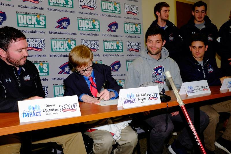 With+the+help+of+Team+IMPACT%2C+13-year-old+Mikey+Dugan+was+drafted+by+the+Robert+Morris+lacrosse+team+during+a+press+conference+on+Feb.+6.+