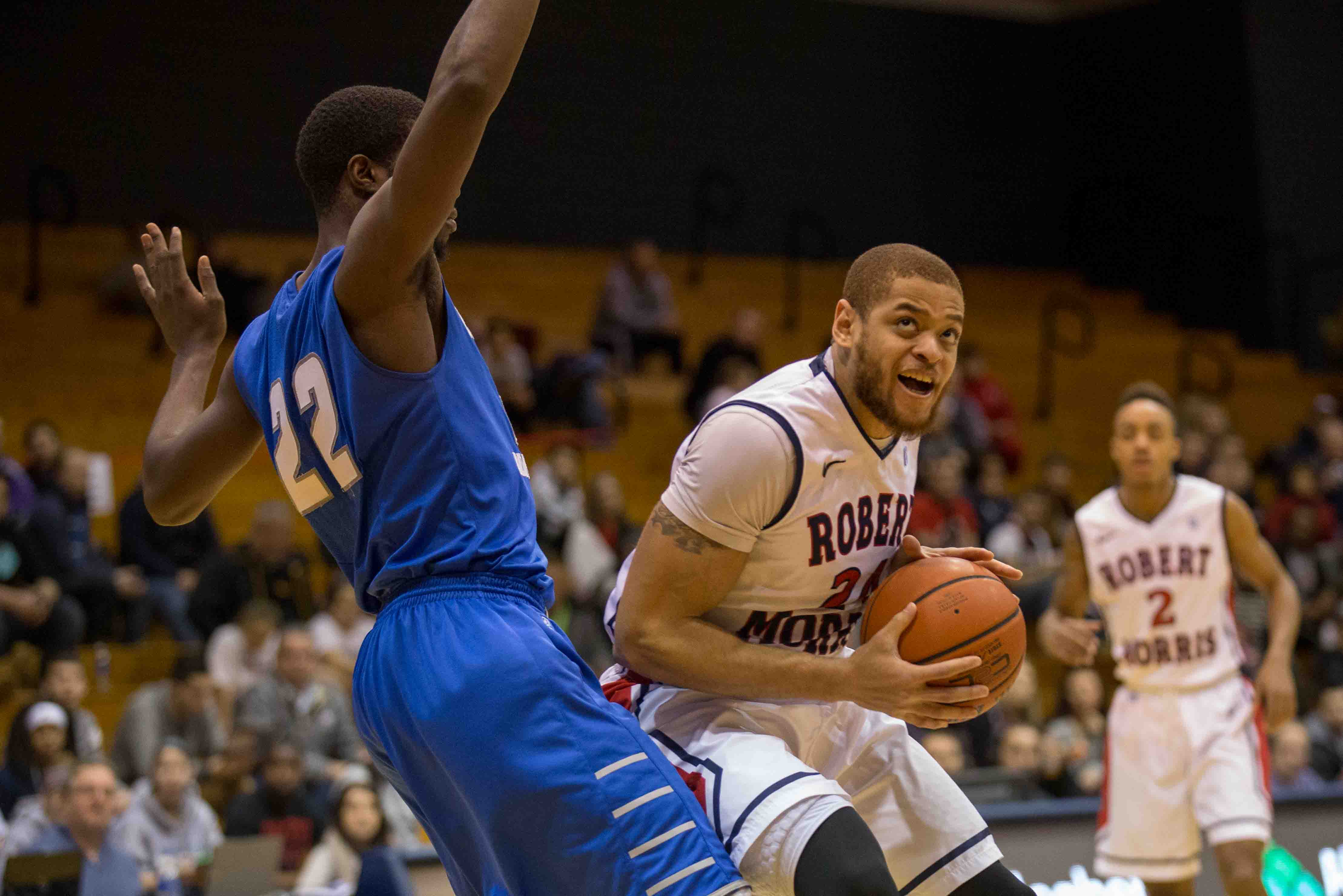 Aaron Tate tipped-in a Marcquise Reed floater as time expired to propel RMU to a 53-52 win over CCSU.
