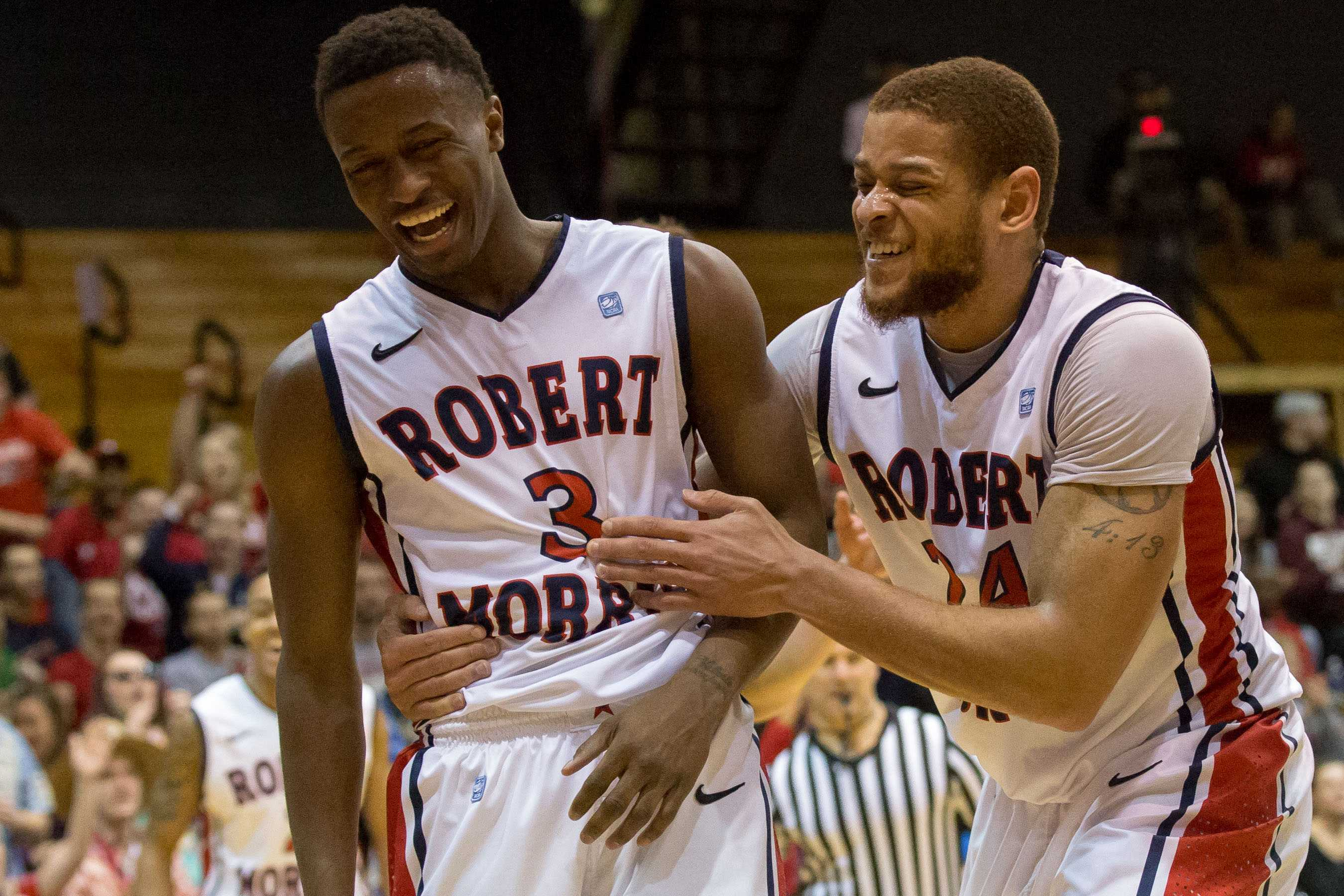 Aaron Tate and Kavon Stewart combined for 23 points Friday to help their team pick up win number one.