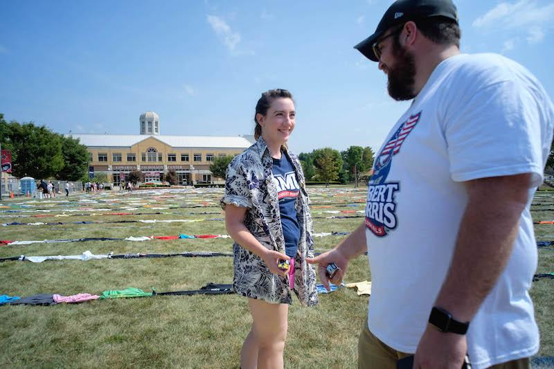 RMU students, lead by Merritt Donoghue, set the world record Saturday August 28th for longest chain of teeshirts tied together. Students worked from 10:00 AM to 1:00 PM to create a 6372 ft 51/2 in chain of teeshirts consisting of 2534 individual teeshirts. The shirts will be donated to a local homeless shelter.