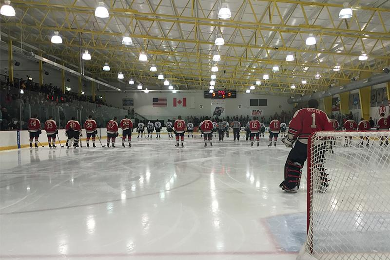 A packed 84 Lumber Arena crowd looks on as players line up for the National Anthem before RMU vs. Mercyhurst.
