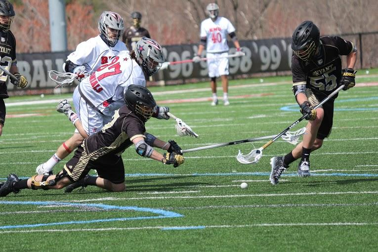 Senior midfielder Chris Barney fights for possession of the ground ball against Bryant