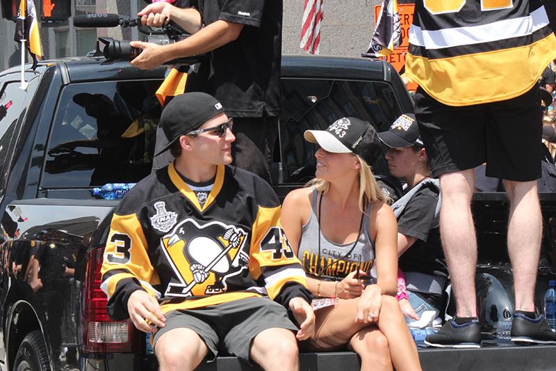 Rookie Conor Sheary (43) looks into the crowd as he sits in the bed of a truck.