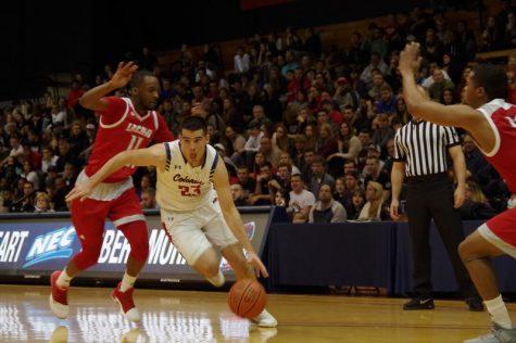 Men's basketball wins behind career night from Still
