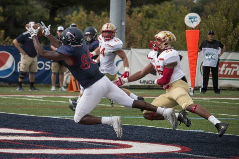 Reggie Green pulls in his first career touchdown grab as a Colonial in the first quarter against VMI Photo credit: Katey Ladika