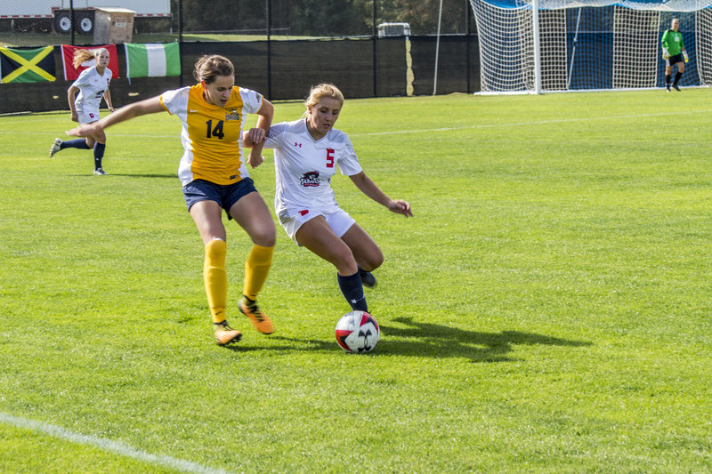 Taylor Burkley for the Colonials battles with Madeline Beaulieu during RMU's 1-0 loss