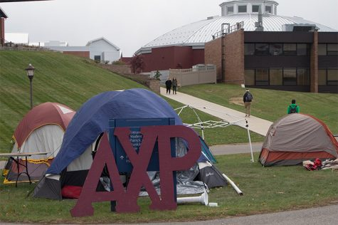 Alpha Chi Rho camping in cold temperatures to raise awareness