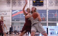Forward Megan Smith is averaging 10.5 points per game this season for the Colonials.