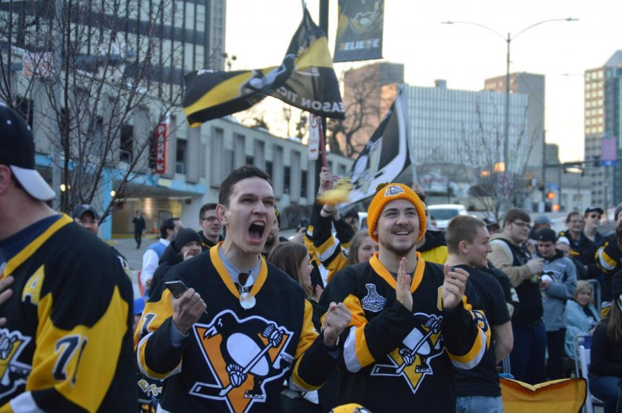 Penguin fans show their support as they watch the game on the big screen.