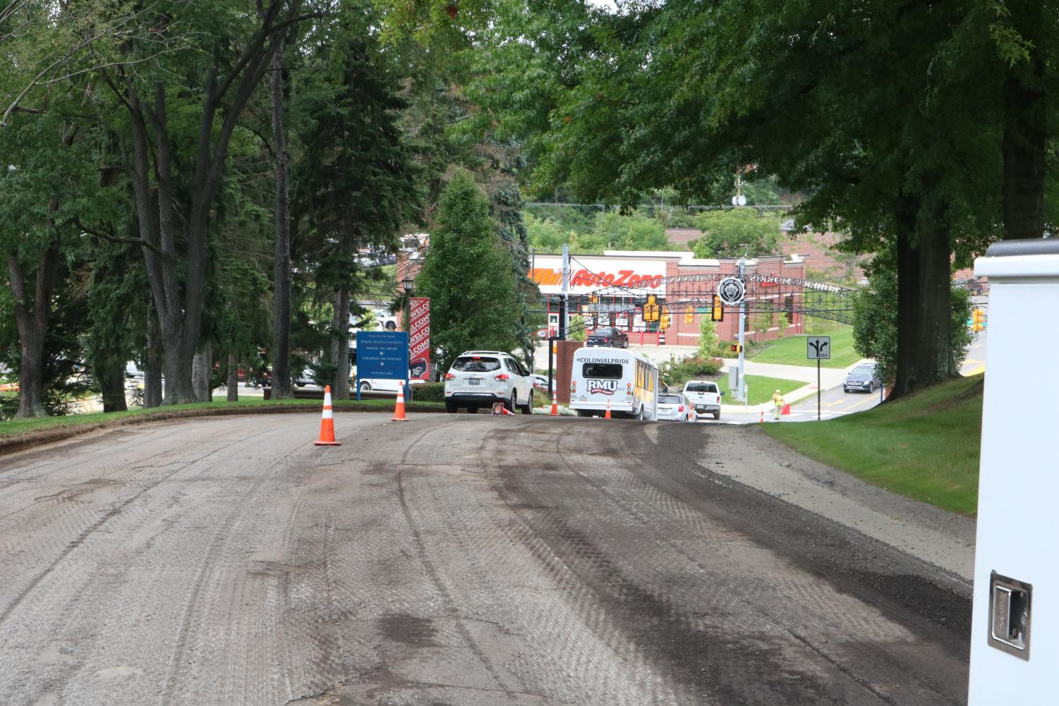 Construction crews milled the entrance to Robert Morris university on Monday, August 20, 2018.