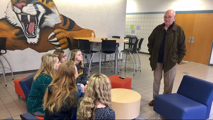 Dennis Frandsen chats with seniors at Rush City High School. (Photo: Boyd Huppert, KARE 11)