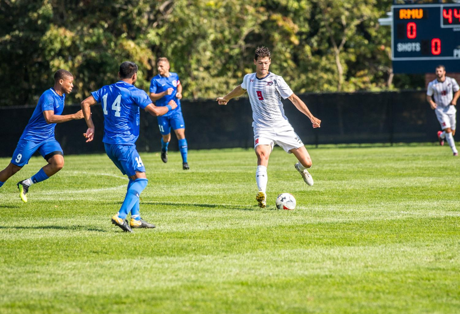 Guilherme Fanck passes the ball during a game against Saint Francis Brooklyn Photo credit: David Auth