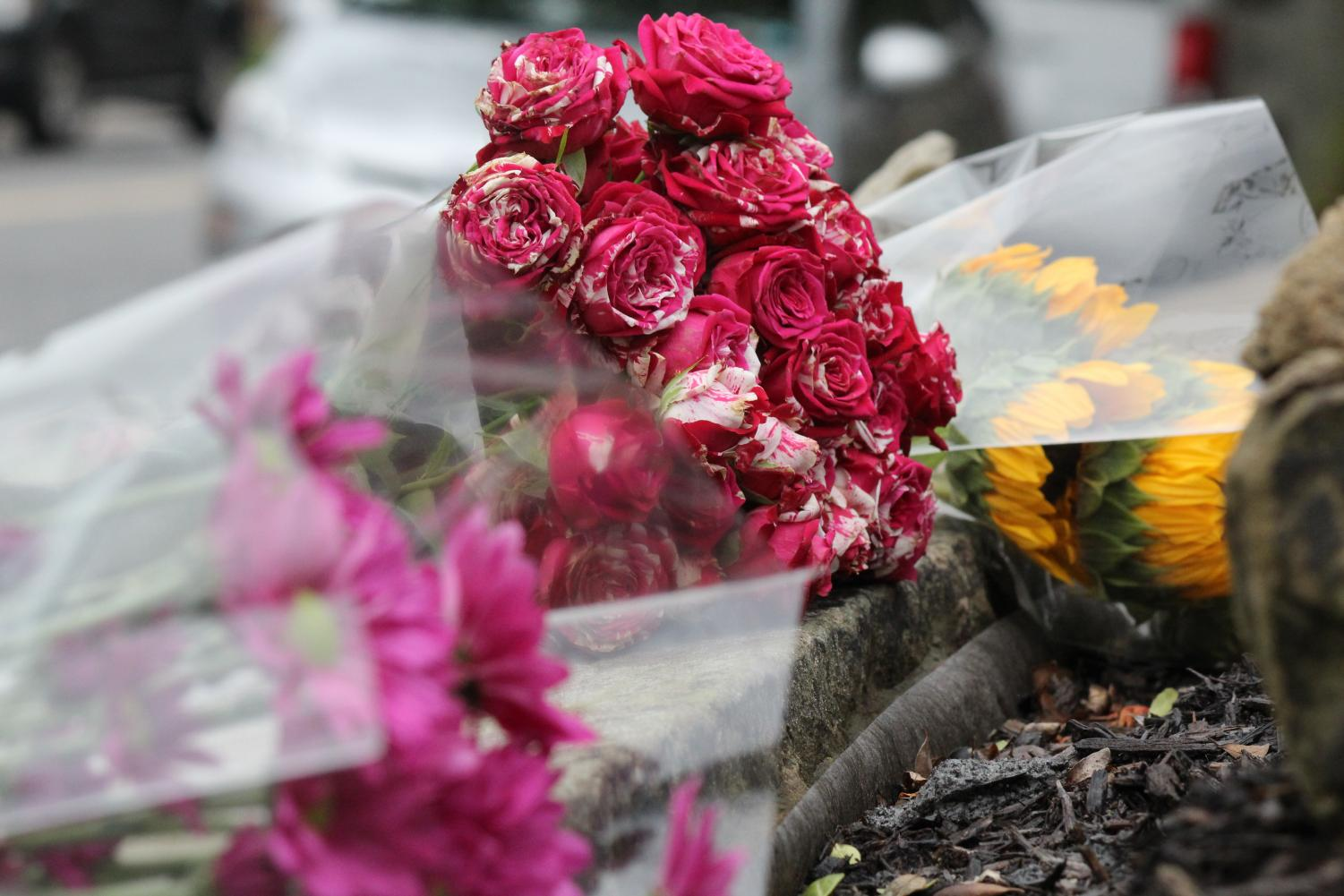 People in and around the Pittsburgh area traveled to the scene with flowers on October 27, 2018 to pay respects to the victims of the shooting at the Tree of Life Synagogue in Squirrel Hill.