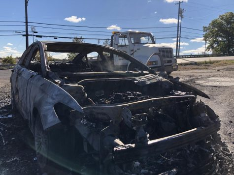Flames engulf, destroy car on University Blvd.