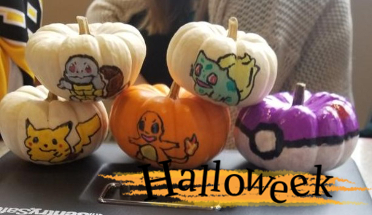 Pumpkins decorated to look like different Pokémon characters (from top left) Squirtle, Bulbasaur, Pikachu, Charmander, and a Pokéball.