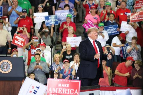 President Donald Trump gives the crowd a thumbs up for the thousands of people at the Erie Insurance Arena in Erie, Pennsylvania on October 10, 2018.