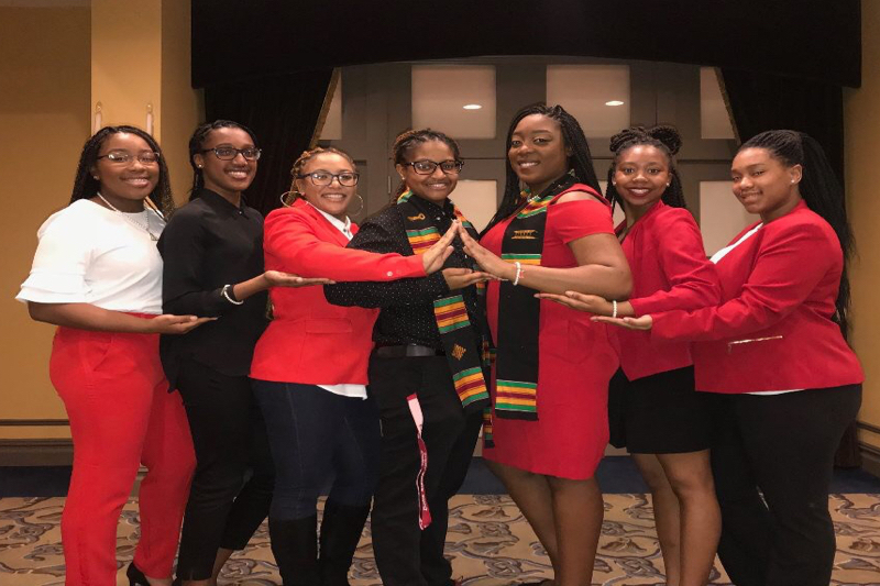 Aliyah Johnson, Nyla Williams, Deloris Jackson, DeSeana Butler, Monet Wade, Janelle Darby and Maliya Morris (left to right) attend a senior celebration event hosted by Multicultural Student Services. Photo credit: Maliya Morris