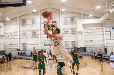 Men's basketball reaches century mark in win over D-III Hood
