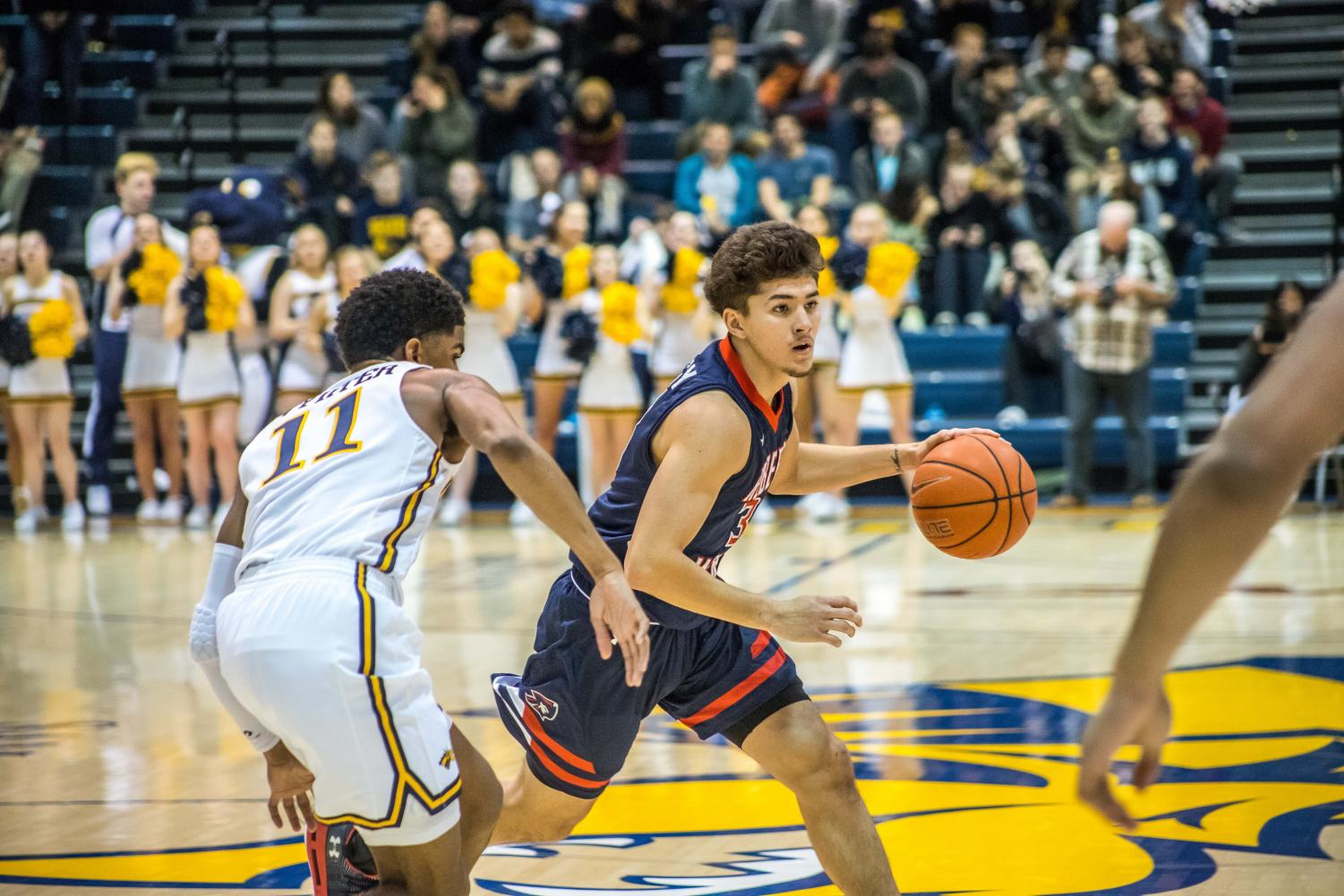 Dante Treacy surveys the Drexel defense in the Colonials 82-69 loss to the Dragons.