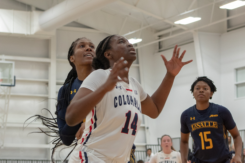 Irekpitan+Ozzy-Momodu+boxes+out+her+opponent+while+attempting+to+get+a+rebound+in+the+Colonials+win+against+La+Salle.