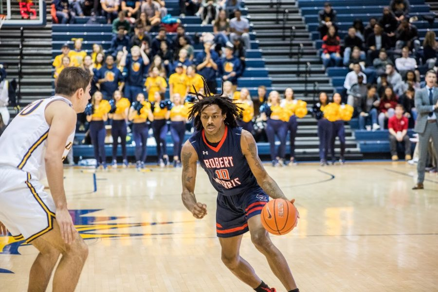PHILADELPHIA — Koby Thomas drives to the hoop against Drexel on December 1, 2018 (David Auth/RMU Sentry Media). Koby Thomas has only appeared in three games since the 82-69 loss to Drexel. Photo credit: David Auth