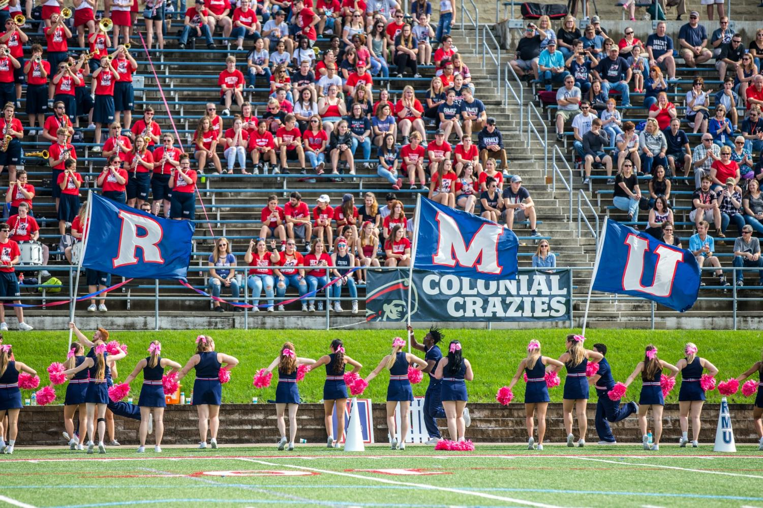 Cheerleaders lead the Colonial Crazies in a cheer. (David Auth/RMU Sentry Media) Photo credit: David Auth