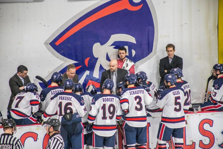 The Robert Morris men's hockey team discusses a play during a game against Niagara Nov. 2, 2018. (David Auth/RMU Sentry Media) Photo credit: David Auth