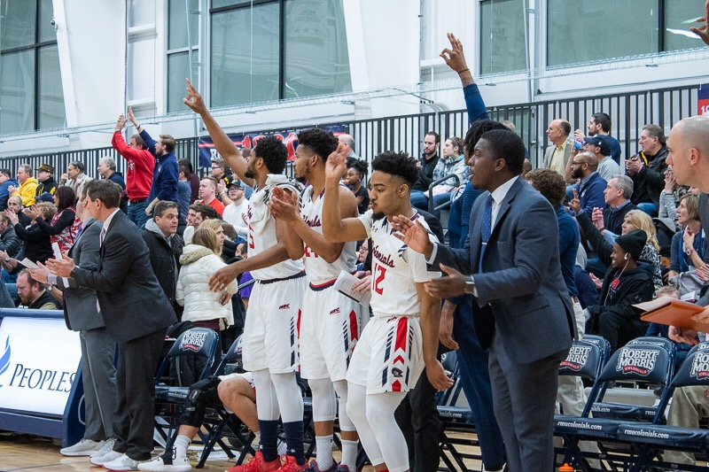 MOON TOWNSHIP — The RMU men's basketball team celebrates after a made three-pointer against Sacred Heart (Samuel Anthony/RMU Sentry Media).