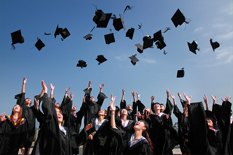 Newly+Graduated+People+Wearing+Black+Academy+Gowns+Throwing+Hats+Up+in+the+Air.+Photo+Credit%3A+%28Pexels%29