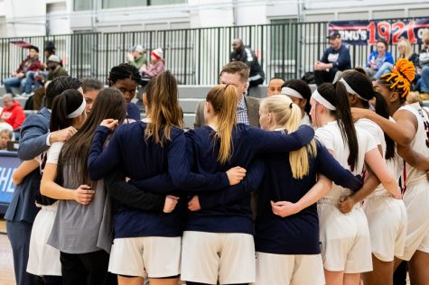 The RMU Women's Basketball team huddles up during the media timeout. Moon Twp, PA Jan. 28, 2019. (RMU Sentry Media/Samuel Anthony)