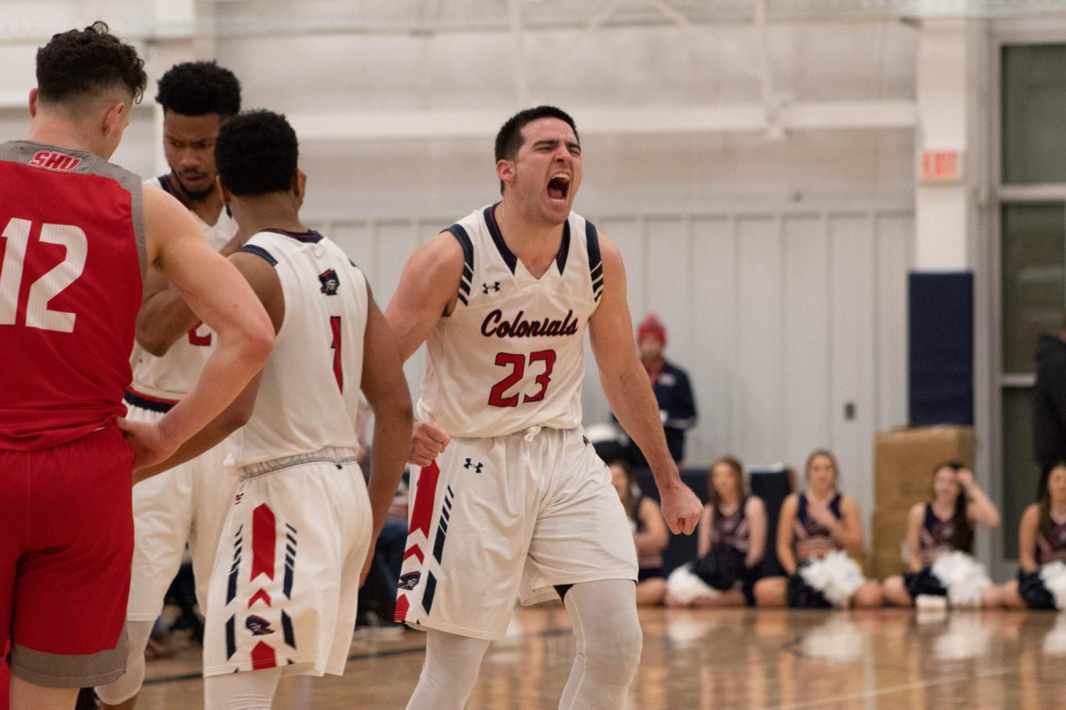 MOON TOWNSHIP — Matty McConnell celebrates during the team's victory against Sacred Heart on Thursday Jan. 24, 2019 (Samuel Anthony/RMU Sentry Media). McConnell had a season-high 19 points in the victory. Photo credit: Samuel Anthony