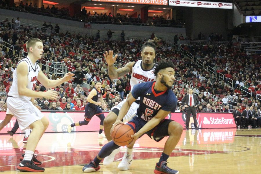 Sayveon McEwen looks for a pass against Louisville on Dec. 21, 2018 (Alex Temple/RMU Sentry Media). Photo credit: Alex Temple