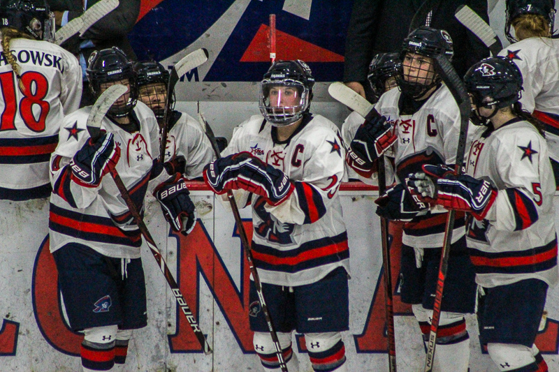 PITTSBURGH -- The women's hockey team rests during a break against St. Lawerence on September 29, 2018. (Samuel Anthony/RMU Sentry Media).