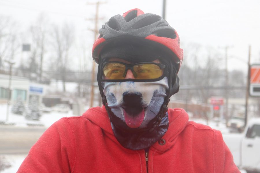 Will O'Donnell, decides the weather is perfect to test his new snow tires for his bike on Feb. 20, 2019.