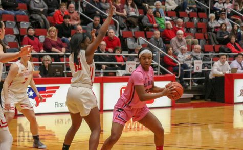 LORETTO, Pa. -- Nadege Pluviose looks for an outlet pass against Saint Francis on February 28, 2019 (Samuel Anthony/RMU Sentry Media).