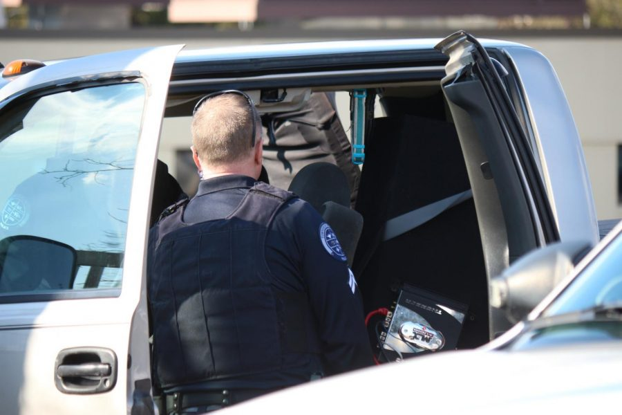 Moon Township and Robert Morris Police search a vehicle in the parking lot of the Benjamin Rush Center.