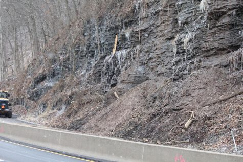 PennDOT crews work to clear a landslide that closed the southbound lanes of University Blvd. in Moon Twp. for nearly a week.