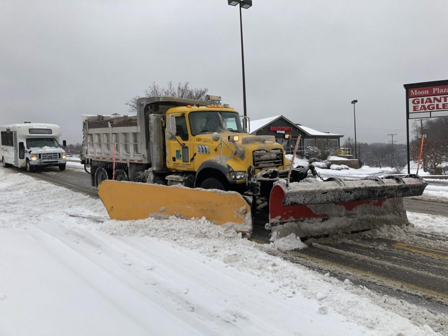 A PennDOT plow truck is using both of its plows to help clear University Boulevard in Moon Township. Photo Credit: (RMU Sentry Media/Gage Goulding)