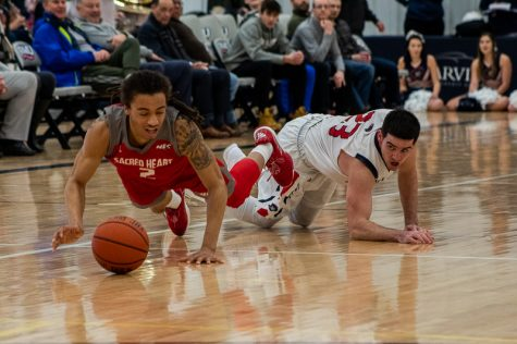 MOON TOWNSHIP -- Matty McConnell pounces on a loose ball against Sacred Heart (Sam Anthony/RMU Sentry Media).