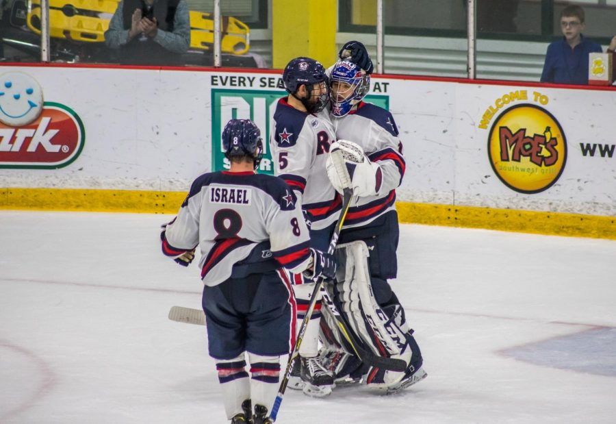 PITTSBURGH+--+The+Colonials+celebrate+a+victory+over+RIT+%28David+Auth%2FRMU+Sentry+Media%29.