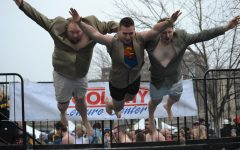 Plungers jump into the cold water during the 2019 Pittsburgh Polar Plunge. Photo Credit: (Flickr/Special Olympics Pennsylvania)